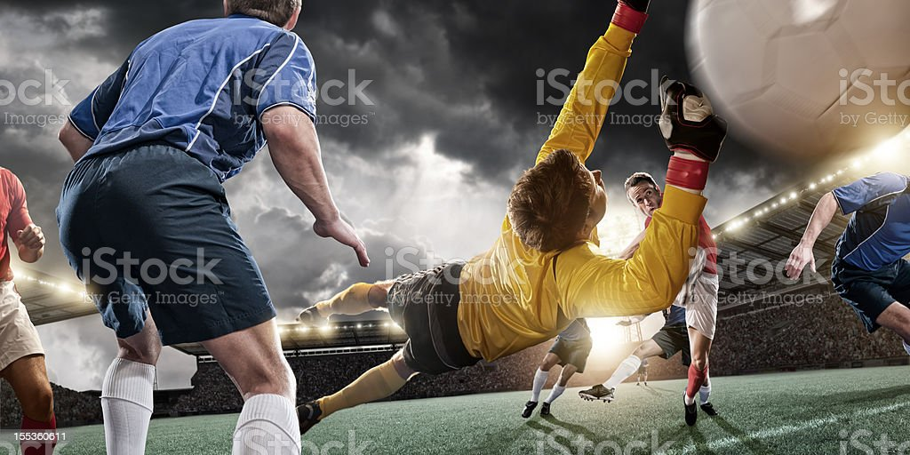Goalkeeper in Mid Air Dive royalty-free stock photo
