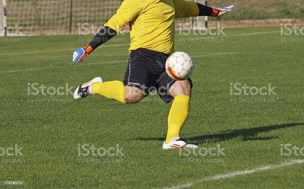 goalkeeper kicks off the ball royalty-free stock photo