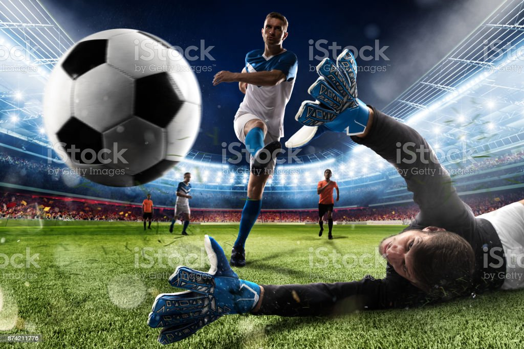 Goalkeeper kicks the ball in the stadium stock photo
