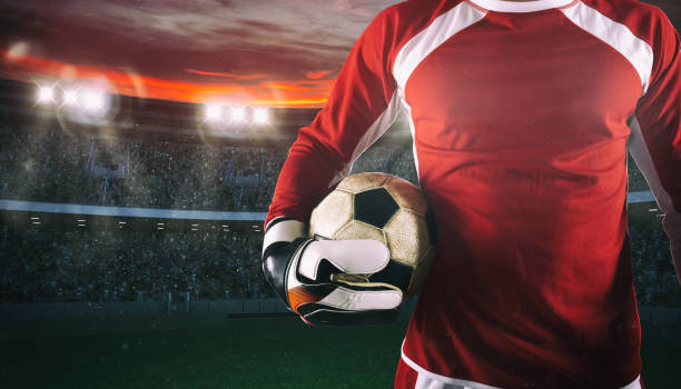 Goalkeeper ready to play with ball in his hands at the stadium stock photo