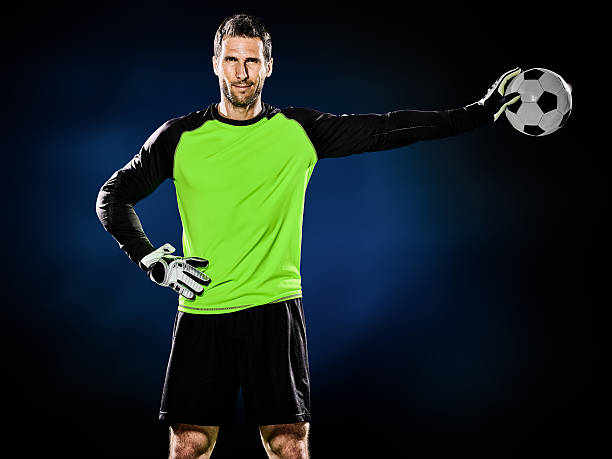 goalkeeper soccer man isolated one caucasian goalkeeper soccer man isolated on black background fine art portrait stock pictures, royalty-free photos & images