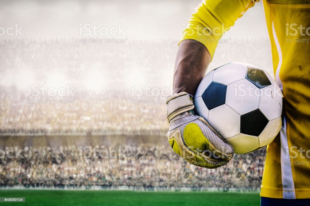 goalkeeper with a soccer ball in the stadium stock photo