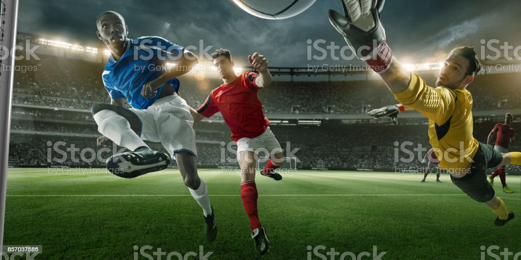 Goalmouth View of Soccer Player Scoring With Mid-Air Volley stock photo