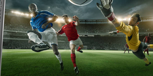 goalmouth view of soccer player scoring with mid-air volley - soccer league stock pictures, royalty-free photos & images