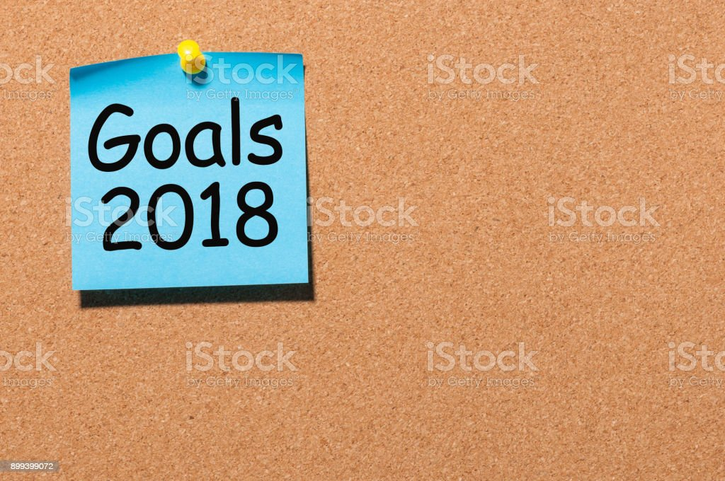 Goals 2018 text on blue note pinned to cork board. New Year's promises for the next year, Mock up stock photo