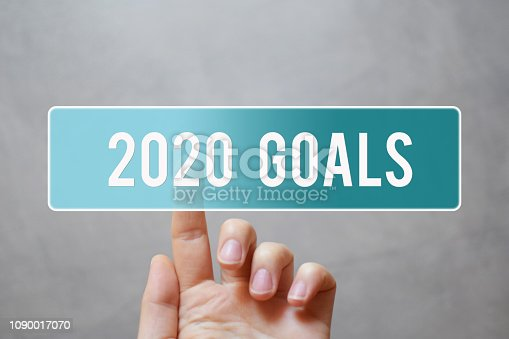 istock 2020 goals - finger pressing button 1090017070