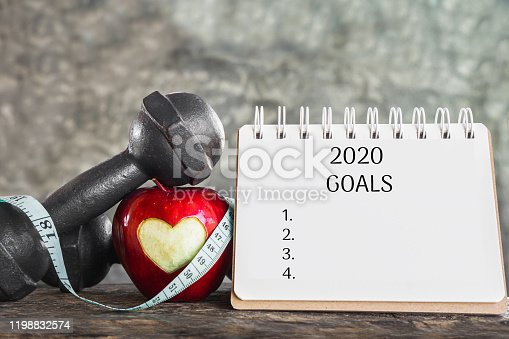 1070617536 istock photo 2020 goals for sport concept with red apple,dumbbell and resolution list on paper 1198832574