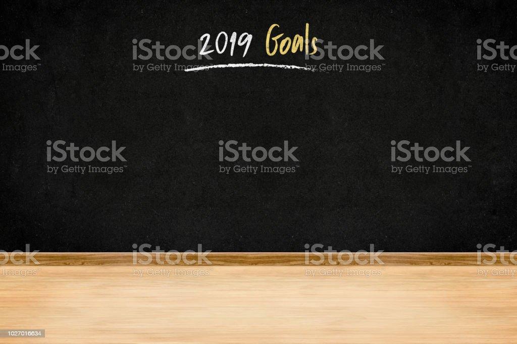 2019 goals handwriting on blackboard wall on wood plank floor,New...