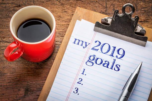 2019 goals on blackboard on clipboard stock photo