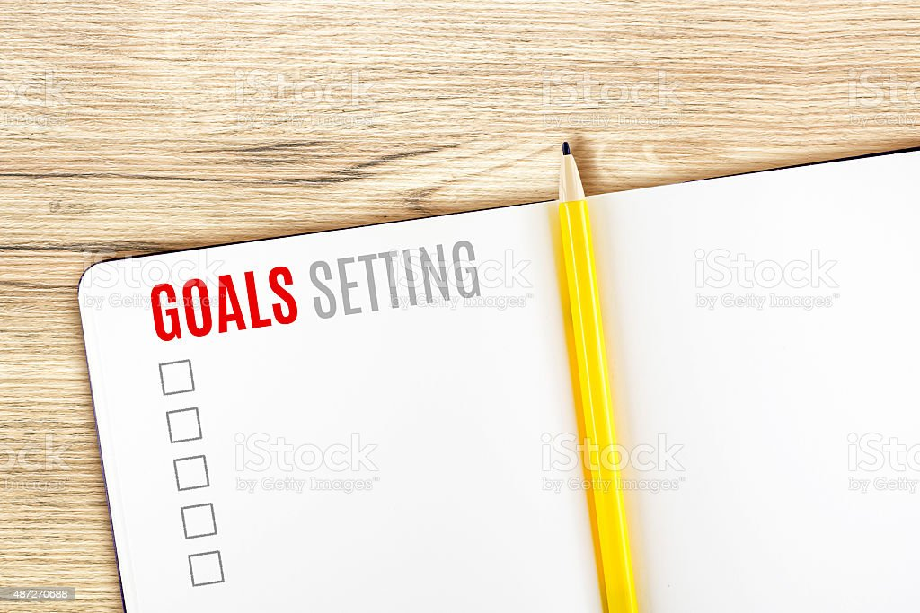 Goals Setting word on notebook lay on wood table stock photo