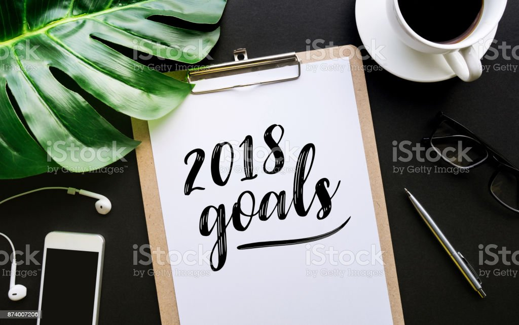 2018 goals text writing on notepaper and accessories stock photo