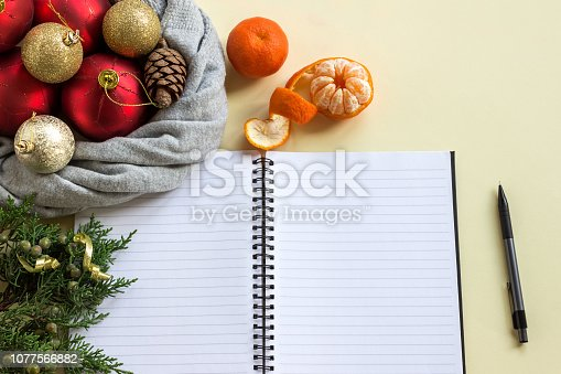 888342518istockphoto 2019 goals. To do list in notepad next to Christmas decorations, cones and tangerines. Planning concept, New year, Christmas, wishes and dreams, festive mood. 1077566882