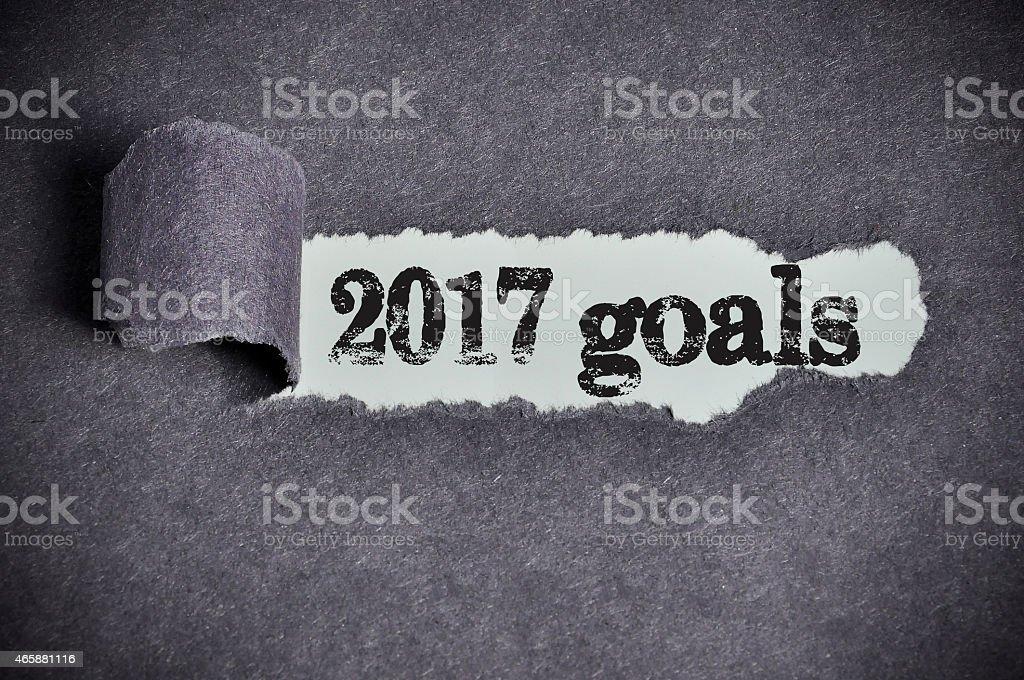 2017 goals word under torn black sugar paper stock photo