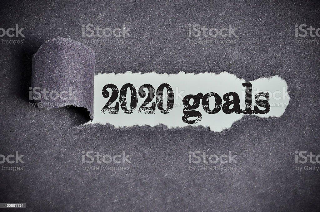 2020 goals word under torn black sugar paper stock photo