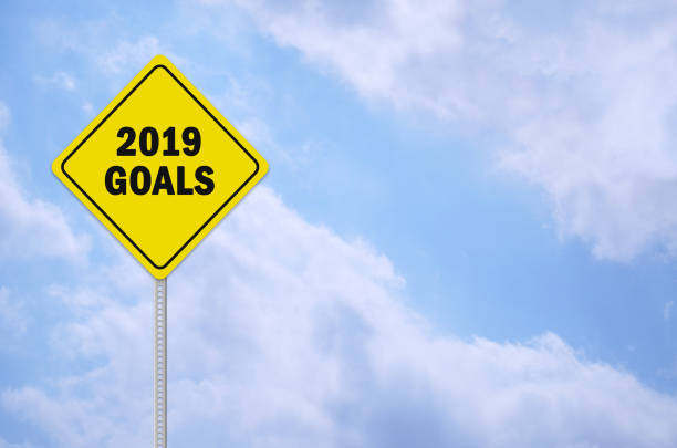 2019 goals written on traffic sign stock photo