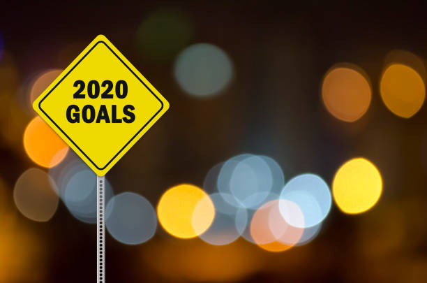 2020 goals written on traffic sign stock photo