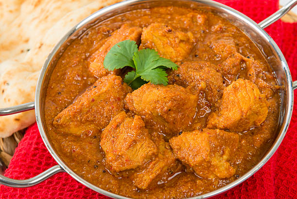 Goan Pork Vindaloo Indian pork curry with naan bread. Traditional cuisine from Goa. balti dish stock pictures, royalty-free photos & images