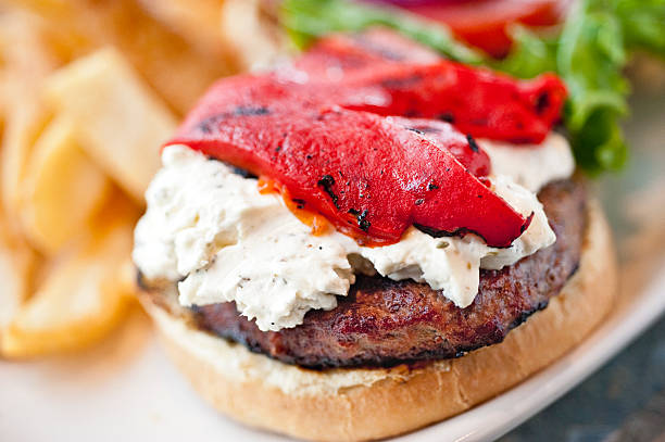 goat cheese and red peppers hamburger - pimento cheese stock photos and pictures