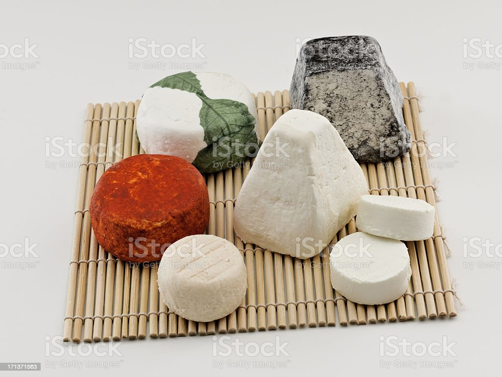 goat cheese assortment on bamboo mat stock photo