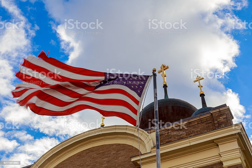 God Bless America American flag and church steeple stock photo