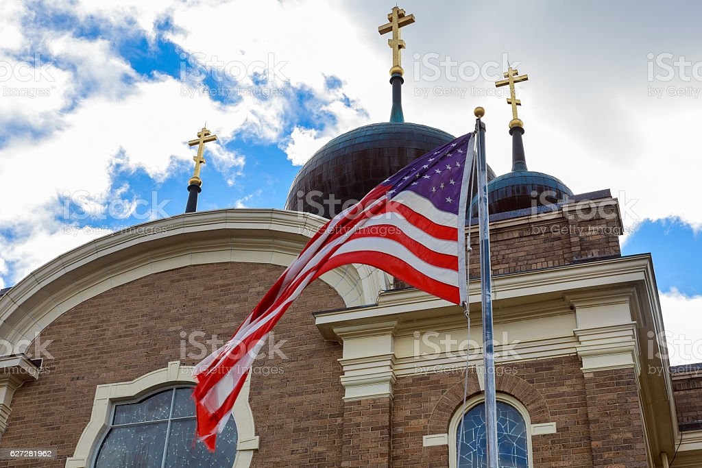 God Bless America American flag and old church steeple reflect stock photo