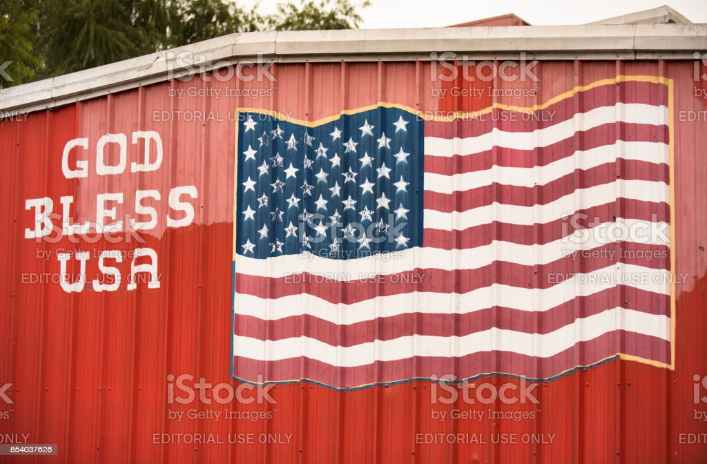 God bless America sign and USA flag stock photo