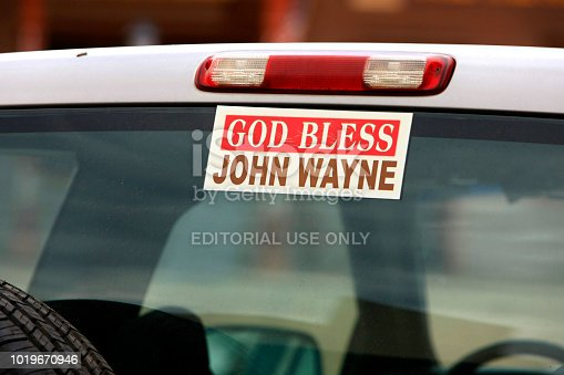 istock God Bless John Wayne bumper sticker on the rear window of a truck seen in Tombstone, Arizona 1019670946