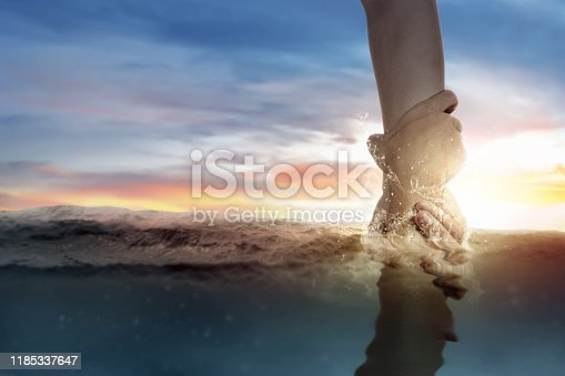istock God giving a helping hand to human 1185337647