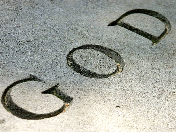God written on stone stock photo