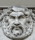 God Zeus is the son of the Titan of Cronus. Head of the gods. The ruler of Mount Olympus. God of lightning and thunder. Greek mythology (Jupiter). Fragment of decoration of the facade of the old building of the European city.