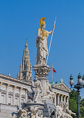 Vienna, Austria - August 8, 2015: The Goddess Athena statue at the top of the Pallas Athene Fountain outside the Austrian Parliament in Vienna