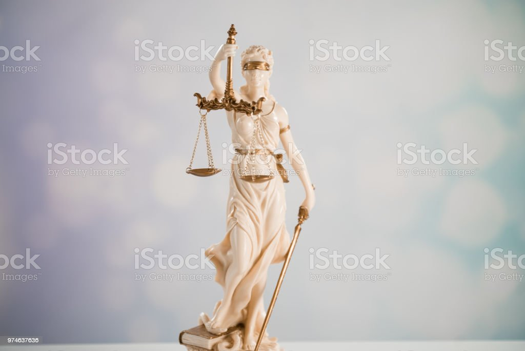 Goddess of justice on a light background stock photo