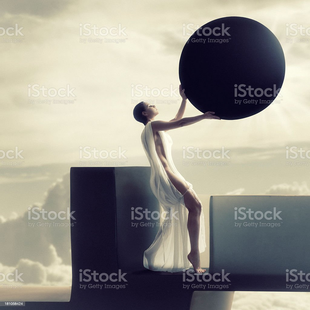 Goddess woman holding moon over sun making a solar eclipse  stock photo