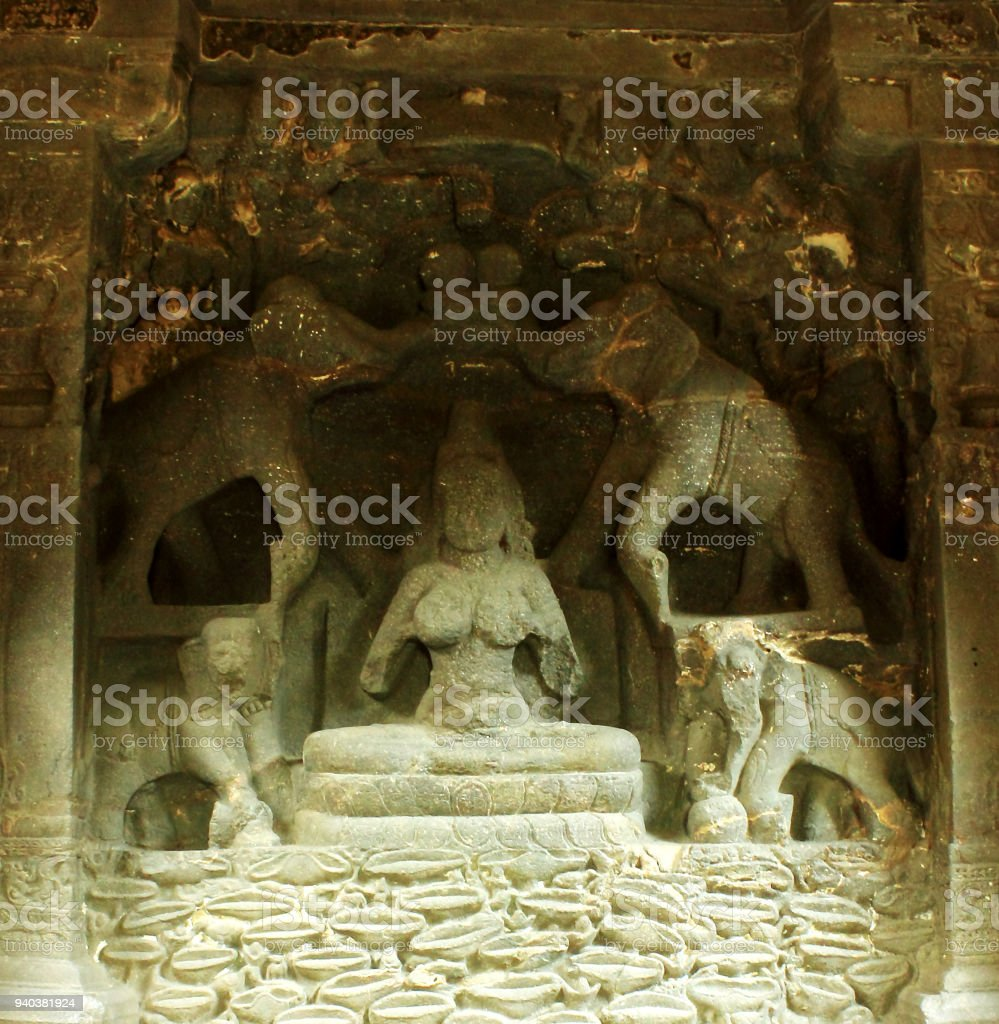 Godess sculpture in Ellora Caves in India - 1000 CE old single rock cut Hindu Kailash temple stock photo