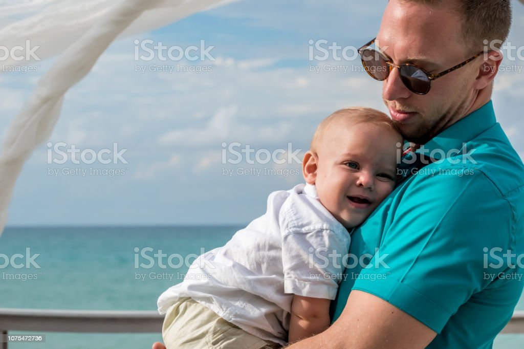 A godfather and his young nephew in a wedding celebration stock photo