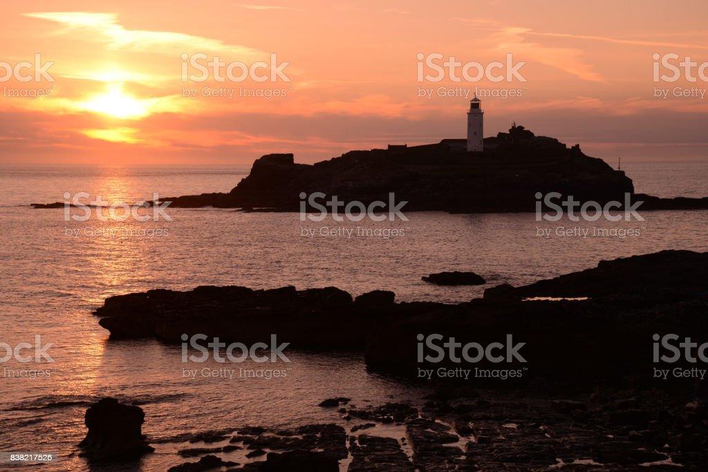 godrevy lighthouse at sunset stock photo
