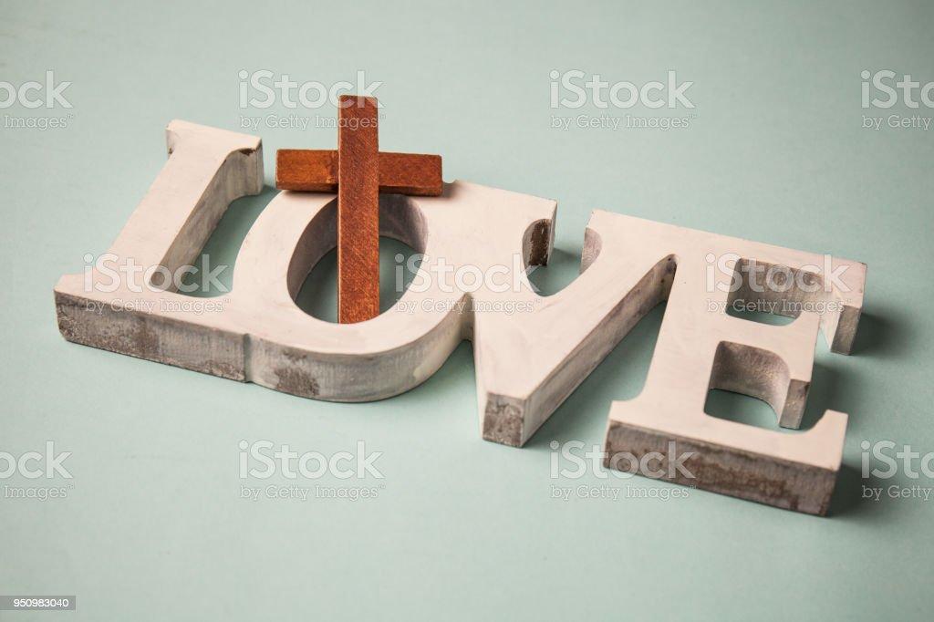 gods love. wooden cross stock photo
