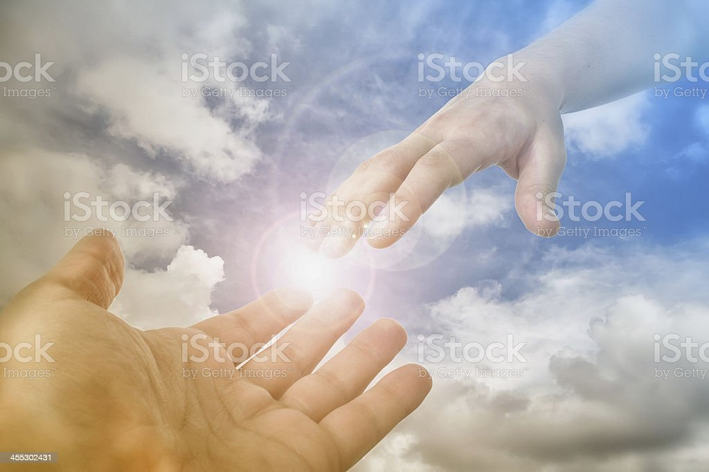 God's Saving Hand reaching for the faithful stock photo