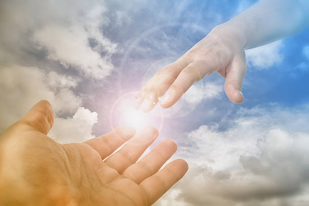 god's saving hand reaching for the faithful - god stock photos and pictures