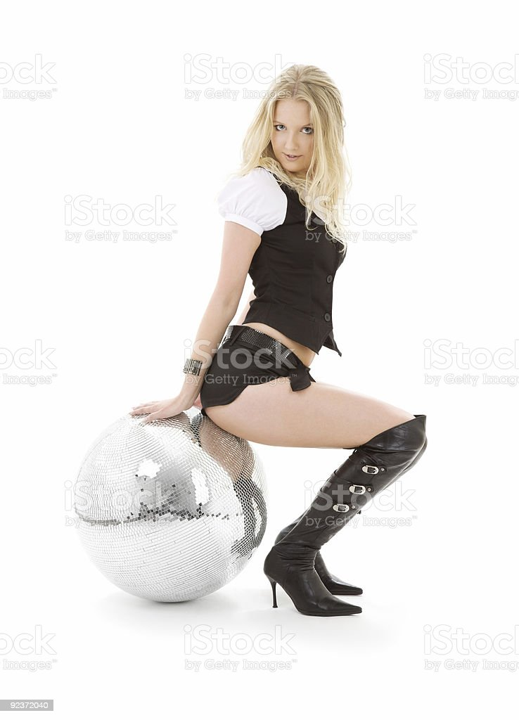go-go dancer in high boots with disco ball stock photo