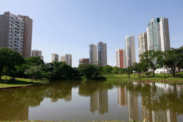 Goiania, Goias, Brazil Water reflects residential buildings close to the park in Goiania, Goias, Brazil goiás city stock pictures, royalty-free photos & images