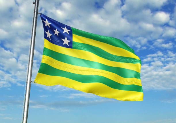 Goias state of Brazil flag waving cloudy sky background Goias state of Brazil flag on flagpole waving cloudy sky background realistic 3d illustration goias stock pictures, royalty-free photos & images