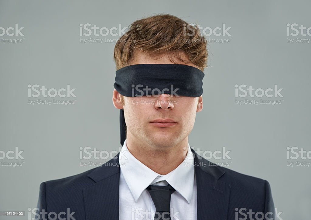 Going blindly into the deal... stock photo