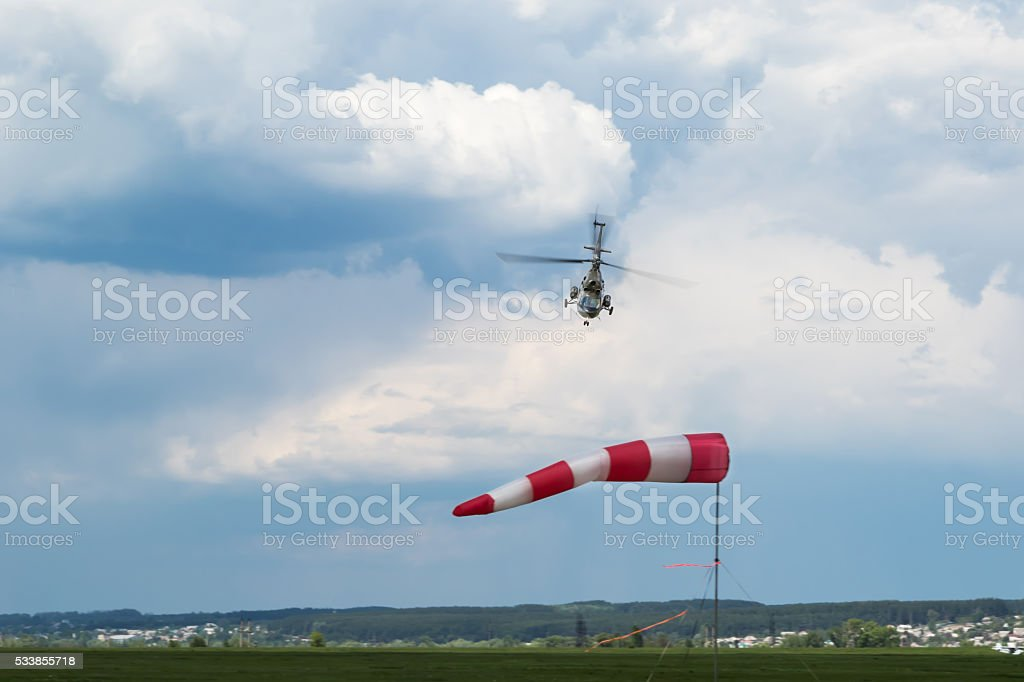 Going for landing helicopter stock photo