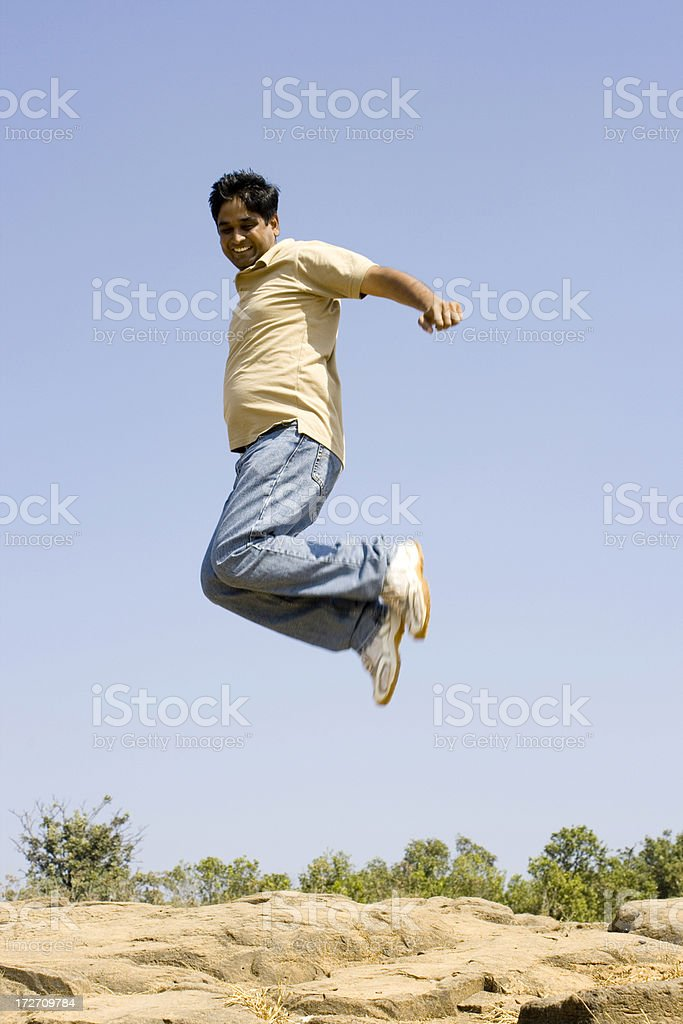 Going High Young Indian man male jumps in a joy royalty-free stock photo