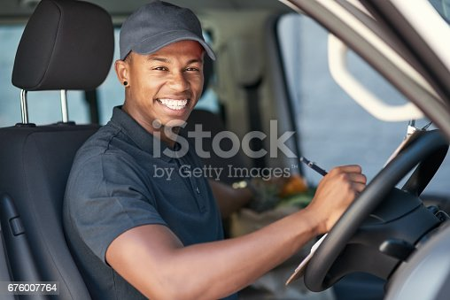 635967404 istock photo Going on his delivery rounds 676007764