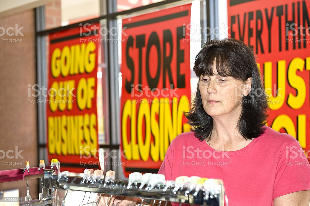 Going Out Of Business Shopper stock photo