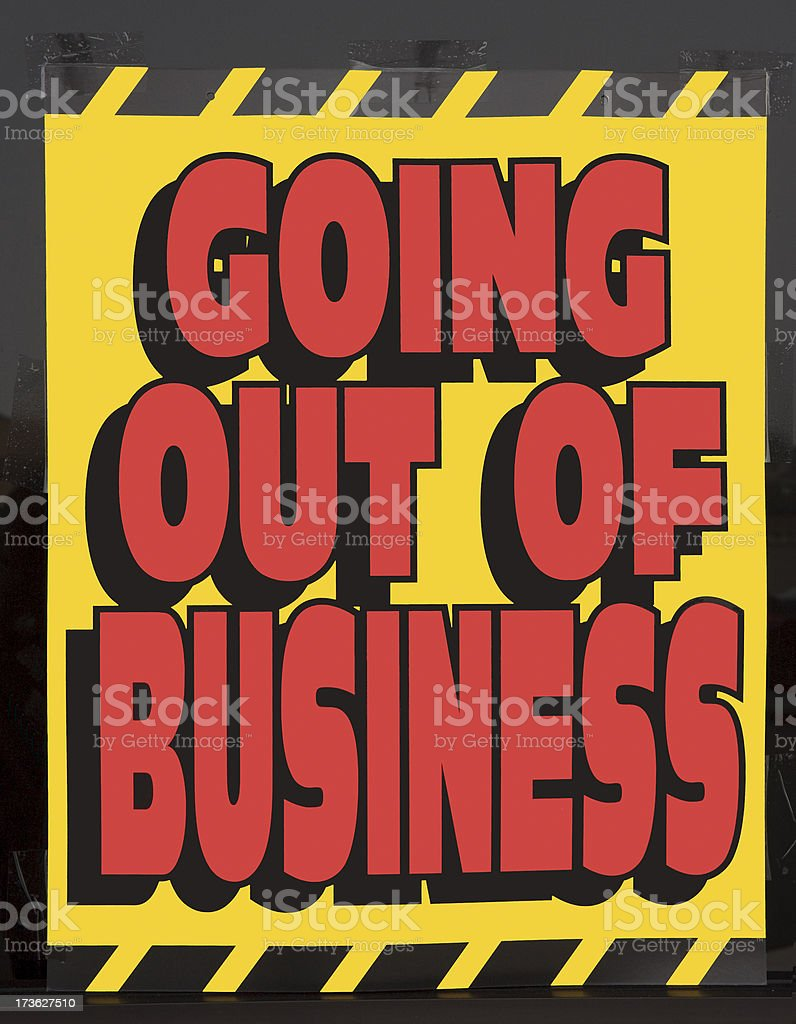 Going out of business window sign stock photo
