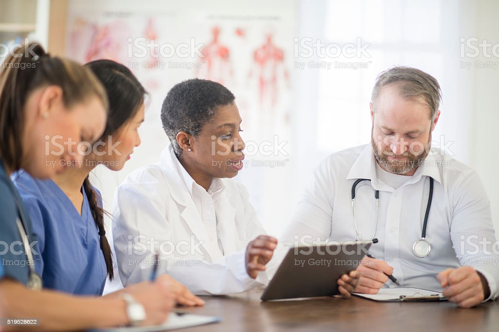 Going Over a Patients Records stock photo