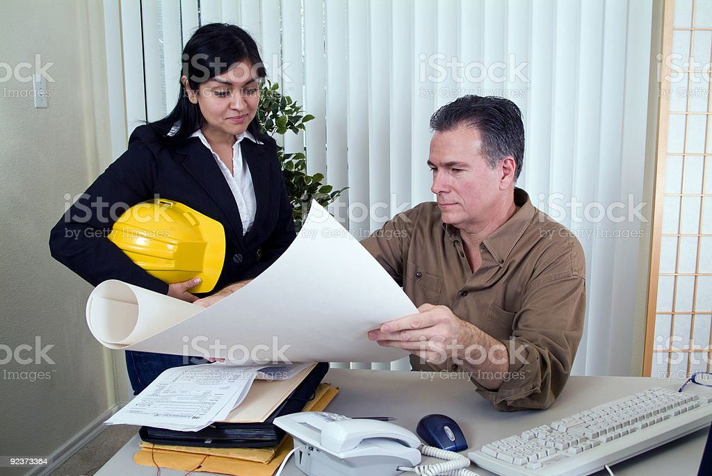 Going Over the Plans royalty-free stock photo